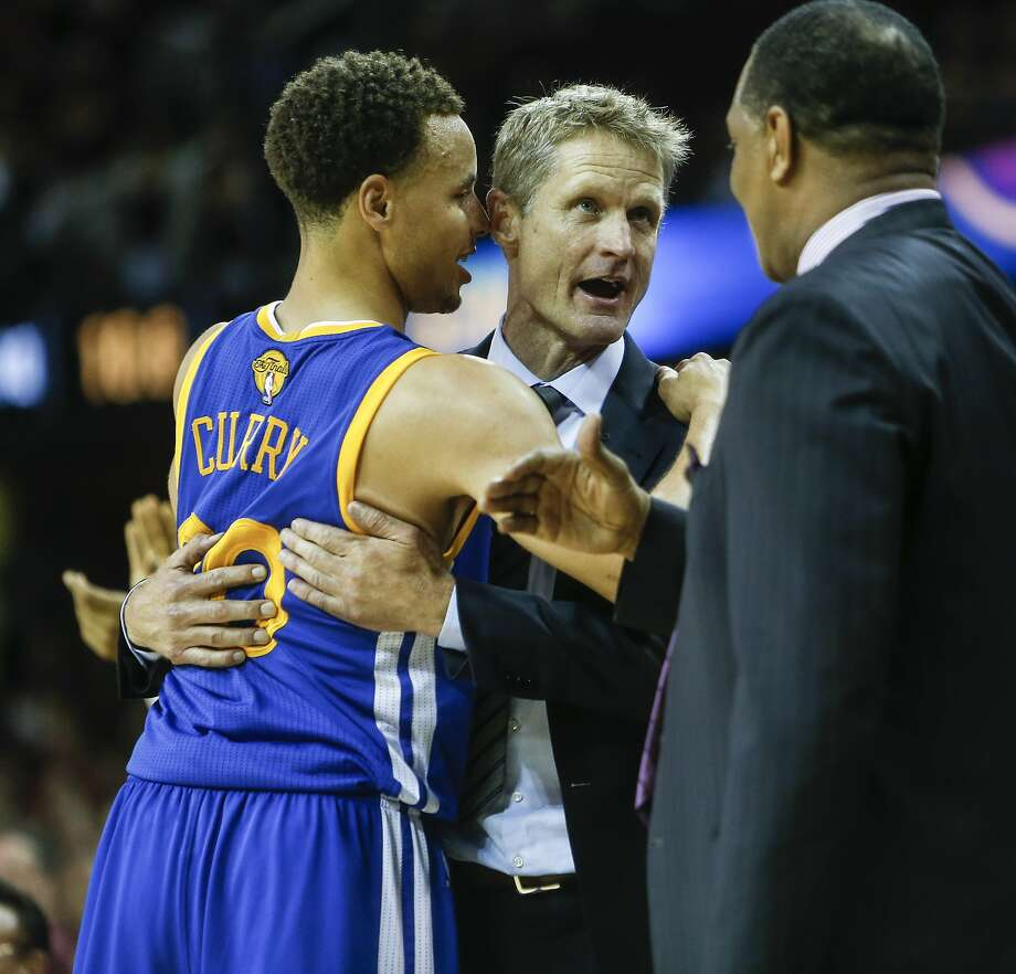 Golden State Warriors' Stephen Curry  and Coach Steve Kerr embrace in the final seconds of Game 6 of The NBA Finals between the Golden State Warriors and Cleveland Cavaliers at The Quicken Loans Arena on Tuesday, June 16, 2015 in Cleveland, Ohio. The Golden State Warriors defeated the Cleveland Cavaliers 105 to 97 to win the NBA Finals title 4 games to 2. Photo: Scott Strazzante, The Chronicle