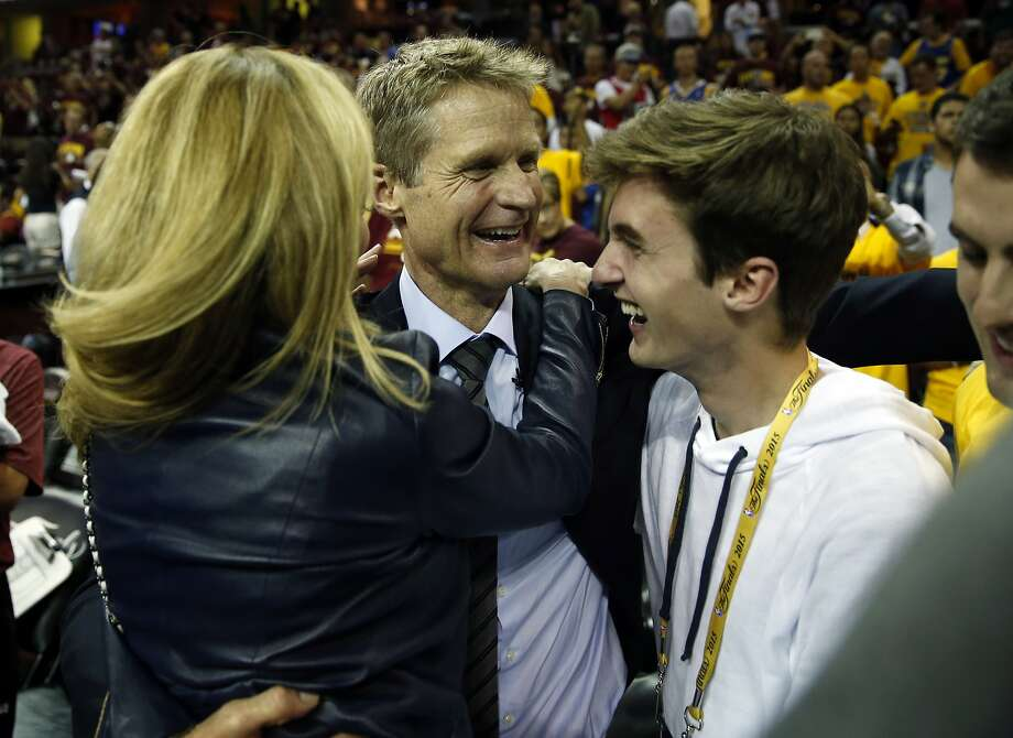 Golden State Warriors' head coach Steve Kerr celebrates with his family after defeating Cleveland Cavaliers in Game 6 of NBA Finals at Quicken Loans Arena in Cleveland, Ohio, on Tuesday, June 16, 2015. Photo: Scott Strazzante, The Chronicle
