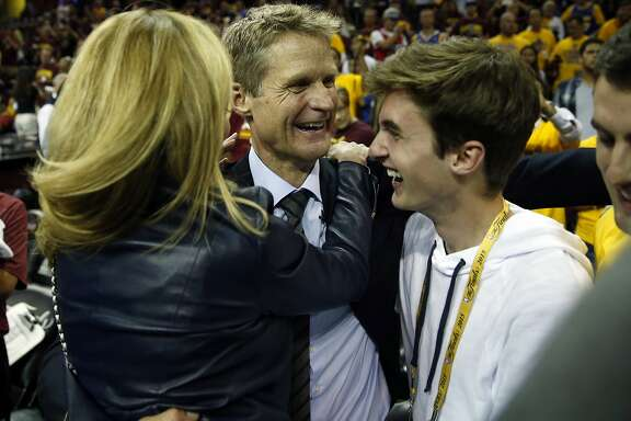 Golden State Warriors' head coach Steve Kerr celebrates with his family after defeating Cleveland Cavaliers in Game 6 of NBA Finals at Quicken Loans Arena in Cleveland, Ohio, on Tuesday, June 16, 2015.
