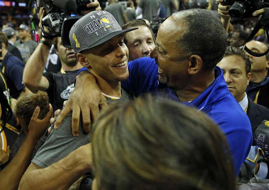 Golden State Warriors' Stephen Curry celebrates with his father Dell Curry after defeating Cleveland Cavaliers in Game 6 of NBA Finals at Quicken Loans Arena in Cleveland, Ohio, on Tuesday, June 16, 2015. Photo: Scott Strazzante, The Chronicle