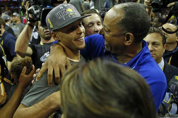 Golden State Warriors' Stephen Curry celebrates with his father Dell Curry after defeating Cleveland Cavaliers in Game 6 of NBA Finals at Quicken Loans Arena in Cleveland, Ohio, on Tuesday, June 16, 2015.