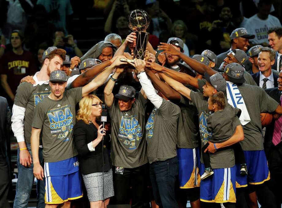 The members of the Golden State Warriors celebrate after winning the NBA Finals against the Cleveland Cavaliers in Cleveland, Wednesday, June 17, 2015. The Warriors defeated the Cavaliers 105-97 to win the best-of-seven game series 4-2. Photo: Paul Sancya, AP / AP