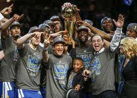 The Golden State Warriors celebrate after Game 6 of The NBA Finals between the Golden State Warriors and Cleveland Cavaliers at The Quicken Loans Arena on Tuesday, June 16, 2015 in Cleveland, Ohio. The Golden State Warriors defeated the Cleveland Cavaliers 105 to 97 to win the NBA Finals title 4 games to 2.