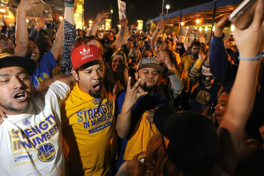 Fans who attended a Game 6 Warriors Watch Party dance  outside Oracle Arena after the Golden State Warriors won the NBA championship at Oracle Arena in Oakland, CA Tuesday, June 16, 2015. Photo: Michael Short, Special To The Chronicle