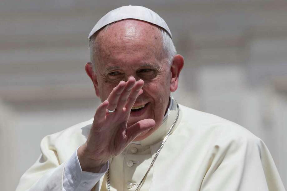 A draft of Pope Francis'encyclical on the environment makes the point that the threat of climate change is real. Here, he waves as he leaves at the end of his weekly general audience, in St. Peter's Square at the Vatican on Wednesday. Photo: Andrew Medichini /Associated Press / AP