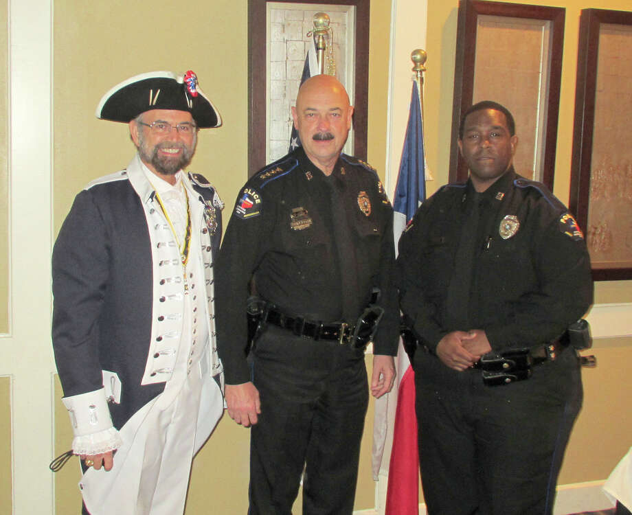 Police: Board of Trustees Vice President Tom Jackson, left, vice president of Robert Rankin Chapter No. 62 of the Texas Society of the Sons of the American Revolution, recognizes CFISD Chief of Police Alan Bragg, center, and CFISD police officer Faladrick Brown for their exceptional service to the community during a ceremony on May 13. Photo: Courtesy