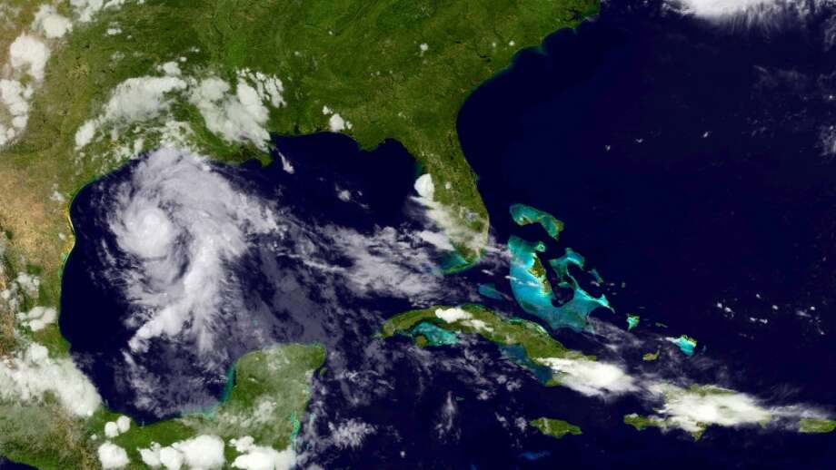 This visible satellite image of the Gulf of Mexico on Monday evening shows the appearance of  proto-Tropical Storm Bill shortly before the National Hurricane Center officially named the storm. Photo: NOAA