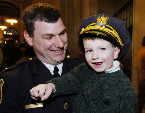 Times Union Staff photo by Skip Dickstein -  Three year old Spencer Cox wears his dads uniform hat after his dad, Brendan Cox, received his lieutenant's bars at the promotion ceremony held in Albany, NY, City Hall March 17, 2004. ORG XMIT: MER2015061618555328 Photo: SKIP DICKSTEIN / ALBANY TIMES UNION