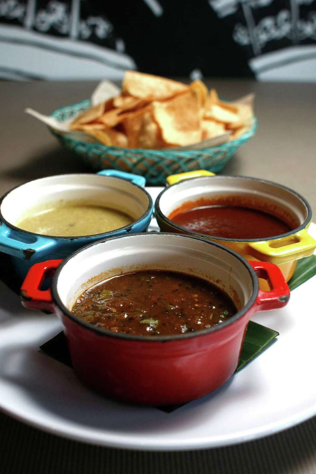 Trio of salsas, Aunt Martha with tomatillos and peanuts, left, five chiles with five peppers and pork rinds, right, and burnt pepper skin, center at Cuchara Friday, Nov. 9, 2012, in Houston. ( Johnny Hanson / Houston Chronicle )