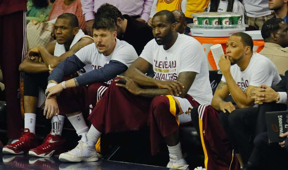 From left, the Cleveland Cavaliers' James Jones, Mike Miller, Kendrick Perkins and Shawn Marion sit on the bench as time runs down during the fourth quarter against the Golden State Warriors in Game 6 of the NBA Finals at Quicken Loans Arena in Cleveland on Tuesday, June 16, 2015. The Warriors won, 105-97, to clinch the championship. (Ed Suba Jr./Akron Beacon Journal/TNS) Photo: McClatchy-Tribune News Service