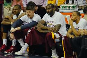 From left, the Cleveland Cavaliers' James Jones, Mike Miller, Kendrick Perkins and Shawn Marion sit on the bench as time runs down during the fourth quarter against the Golden State Warriors in Game 6 of the NBA Finals at Quicken Loans Arena in Cleveland on Tuesday, June 16, 2015. The Warriors won, 105-97, to clinch the championship. (Ed Suba Jr./Akron Beacon Journal/TNS)