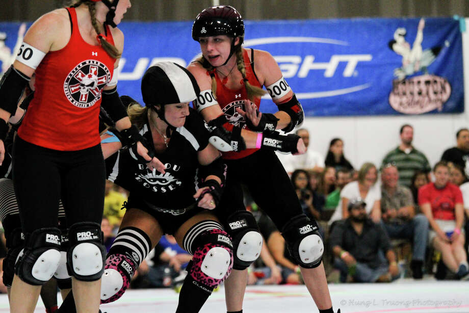 Members of Houston Roller Derby in action. The 2012 season debuts March 17 and the matches will be played in Bayou Music Center (formerly Verizon Wireless). Photo: Hung Truong/Houston Roller Derby / © Hung L. Truong Photography