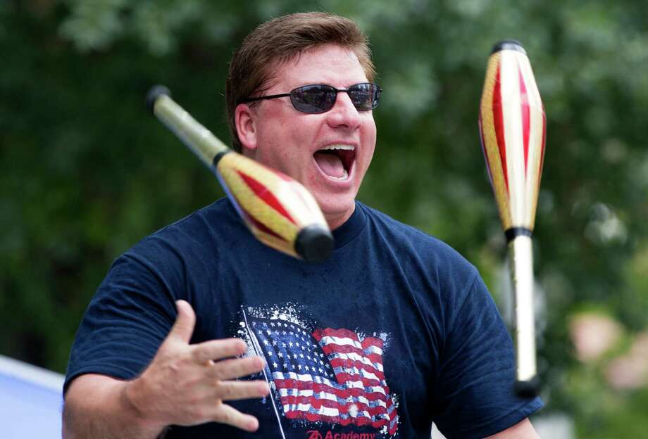 Ted Schwank juggles during the Freedom Over Texas Fourth of July celebration at Eleanor Tinsley Park on Friday, July 4, 2014, in Houston. ( J. Patric Schneider / For the Chronicle ) Photo: J. Patric Schneider, Freelance / © 2014 Houston Chronicle