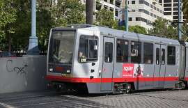 Graffiti is scrawled at the portal of the Muni subway on The Embarcadero in San Francisco, Calif. on Wednesday, June 17, 2015. The District Attorney's office is filing charges against a serial tagger who it says has caused over $50,000 in damages.