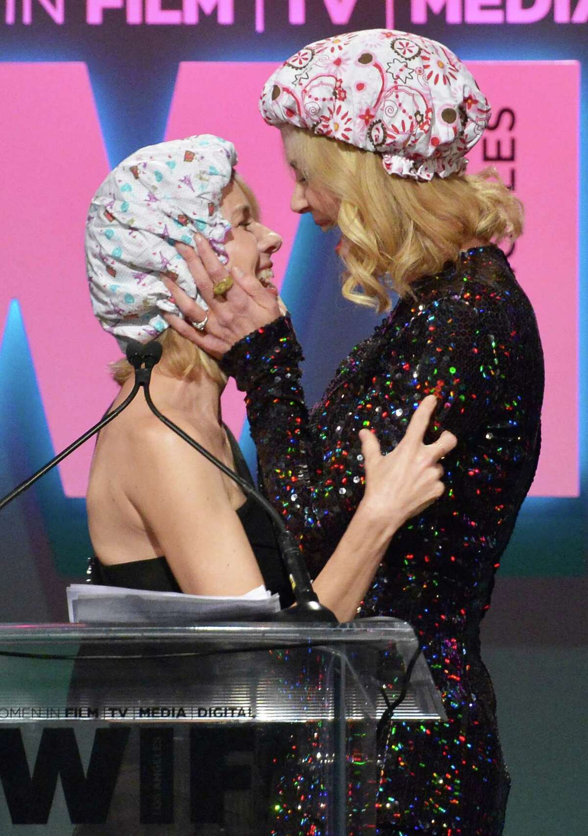 Actress Naomi Watts (L) and honoree Nicole Kidman, recipient of The Crystal Award for Excellence in Film, kiss onstage during the Women In Film 2015 Crystal + Lucy Awards Presented by Max Mara, BMW of North America, and Tiffany & Co. at the Hyatt Regency Century Plaza on June 16, 2015 in Century City, California.