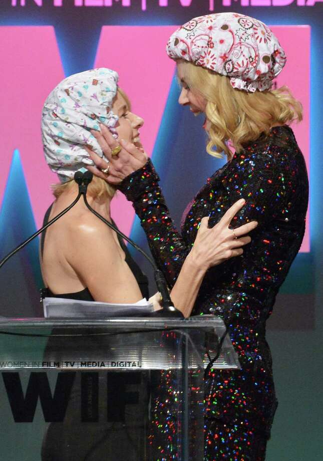 """On Tuesday, Naomi Watts and  Nicole Kidman kissed on stage at the Women In Film 2015 Crystal + Lucy Awards in California ... and it's pretty darn awkward as a series of photos. After all, it was performed with the two sporting bizarrely tacky shower caps. But, as Vanity Fair explains, the kiss had a purpose beyond a headline-grabbing """"two famous actresses kiss!"""" sensationalism (it wasn't that sensational ... as you'll see in the following photos).According to the magazine, """"Kidman  explained that she had been too nervous to take (a part in a movie), because it  would have required her to don a shower cap and kiss a girl on-screen. 'My excuse was that I had final exams to study for, but the truth is the  part would have required me to appear up on the screen wearing a shower  cap and kissing a girl . . . I wanted to be the kind of actress with  long flowing hair [who] kissed boys . . . I was not ready to do the kind  of work that threatened anybody,' she said. 'Well, today I know better  and I say, """"Jane, if you're out there . . . I'm ready to don this cap."""" ' """"Kidman was the recipient of The Crystal Award for Excellence in Film at the event.  Photo: Charley Gallay, Getty Images  / 2015 Getty Images"""