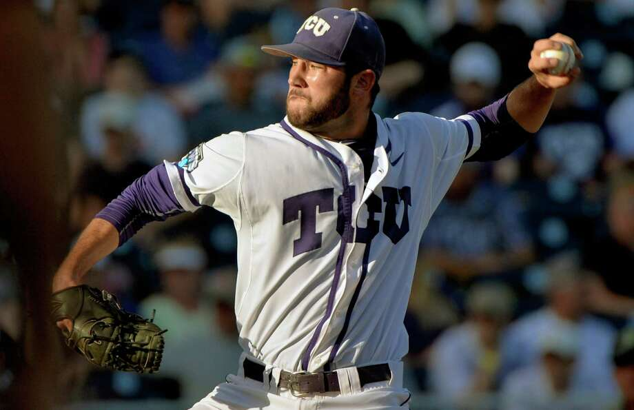 TCU starting pitcher Alex Young (23) works against Vanderbilt in the first inning of an NCAA College World Series baseball game at TD Ameritrade Park in Omaha, Neb., Tuesday, June 16, 2015. (AP Photo/Ted Kirk) Photo: Associated Press / FR34398 AP