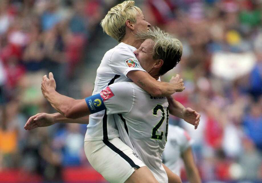 Abby Wambach (right) is congratulated by teammate Megan Rapinoe after scoring the United States' lone goal just before halftime. Photo: Jonathan Hayward / Associated Press / CP