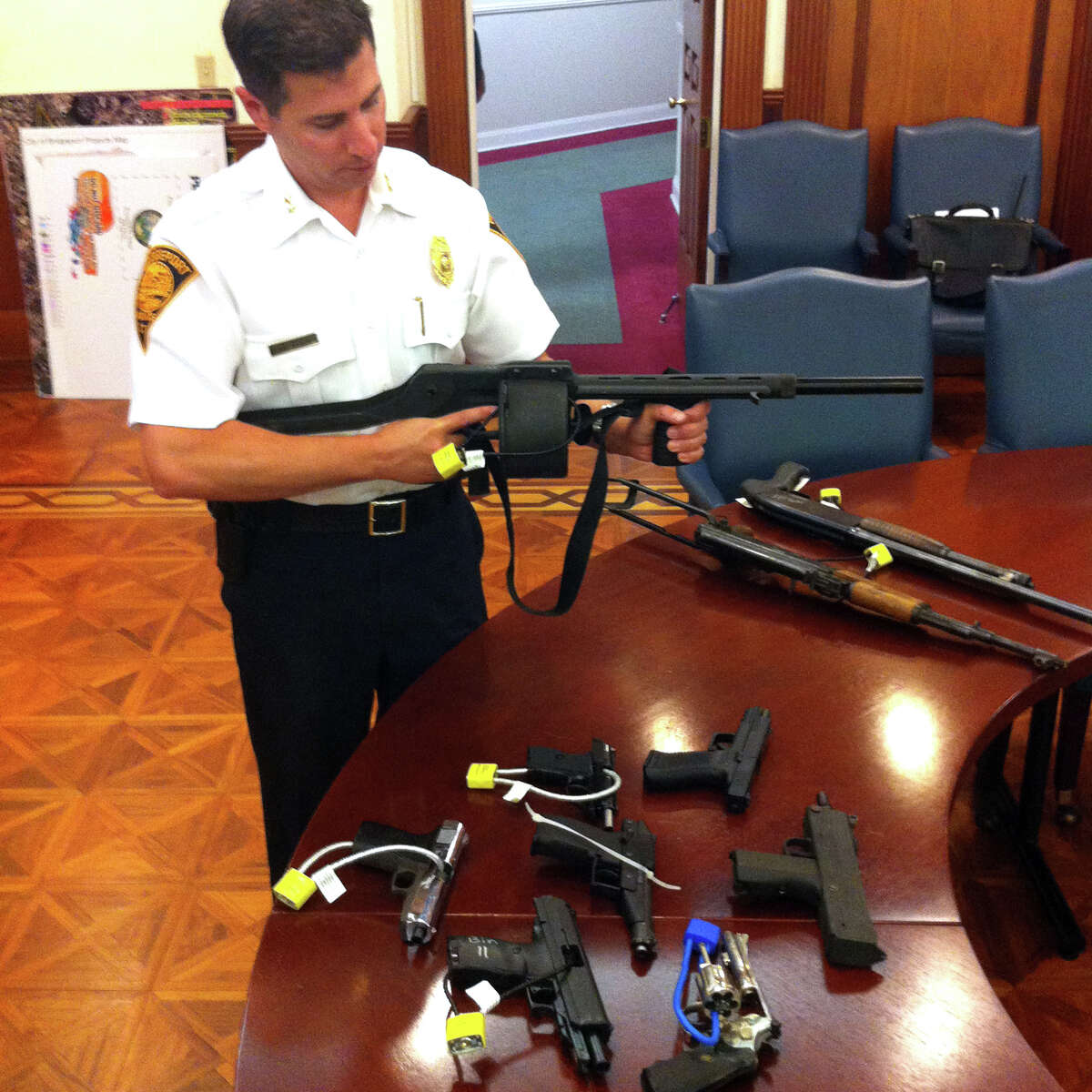 Bridgeport Assistant Police Chief James Nardozzi displays a Streetsweeper shotgun turned in during one of the cityâÄôs previous gun buyback programs.The department is hosting another buyback on Saturday and seeking financial support to help pay for the weapons.