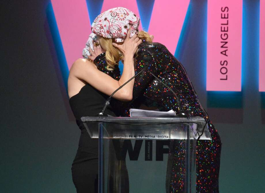 Actress Naomi Watts (L) and honoree Nicole Kidman, recipient of The Crystal Award for Excellence in Film, kiss onstage during the Women In Film 2015 Crystal + Lucy Awards at the Hyatt Regency Century Plaza on June 16, 2015 in Century City, California. (Charley Gallay/Getty)
