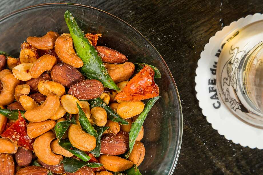 Famous bar nuts with chili and lime leaf. Photo: Jason Henry, Special To The Chronicle