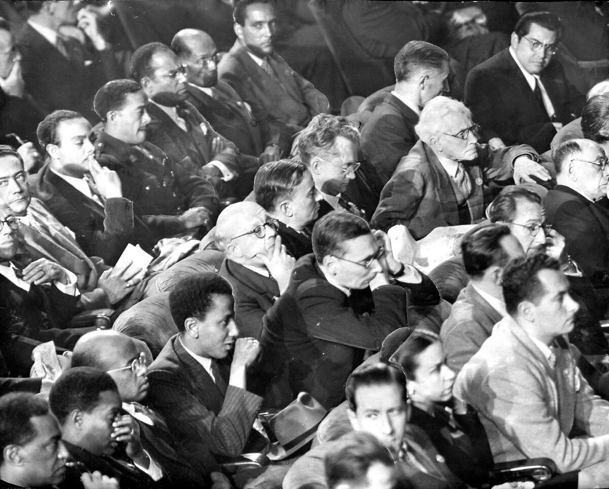 The delegates listen to speakers, In the photo: Haitians occupy the last row, They are (l to r) General Alfred Nemours, Andre Liautaud, Pierre Chauvet, Major Antoine Levelt, Antoine Bervin, Clovis Kernian and Joseph Nadal. In the middle row are Ethiopian representatives sit together at the left., with the rest occupied by French delegates. Leaning forward is Georges Bidault, Minister of Foreign Affairs and chairman of the delegation,and behind him, with his arm on the chair is whit-haired Joseph Paul-Boncour Sittig next to Mr. Paul-Boncour is Henri Bonnet, French ambassador to the U.S. In the front row are the Cuban delegates, Ambassador Guillermo Belt is the first one, facing the camera. Photo ran 04/27/1945, p. 10 Chronicle photo, but a general photographer credit United Nations conference
