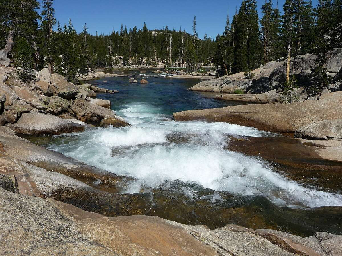 In Yosemite National Park, after flowing through Tuolumne Meadows, the Tuolumne River begins its descent through granite past Glen Aulin (and 10 miles downstream from Tuolumne Meadows into the Grand Canyon of the Tuolumne), a pristine fountain of pure Sierra water. Photo from last weekend.