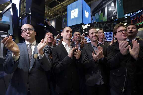 FILE - In this Nov. 7, 2013 file photo, front row, from left, Twitter CEO Dick Costolo, Chairman and co-founder Jack Dorsey, and co-founders Evan Williams and Biz Stone,  applaud as they watch the ringing of the opening bell at the New York Stock Exchange. Despite executive turmoil and a stock price that has fallen 30 percent since late April 2015, industry experts _ not to mention loyal users _ see potential in the company. But first it needs to address some of its biggest problems. (AP Photo/Richard Drew, File)