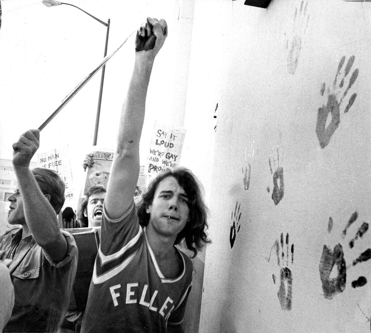Nov. 1, 1969: Picketers support a pro-gay cause in 1969, using paint to make handprints on a San Francisco wall.