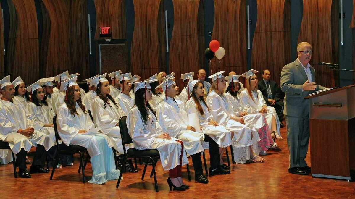Danbury Mayor Mark Boughton speaks at the 2015 graduation ceremony of the Danbury Public Schools Adult Education Program last week.