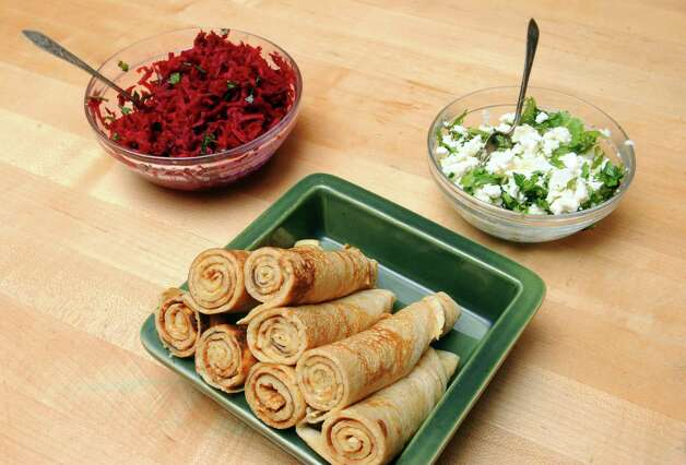 Ethiopian pancakes with cheese and herbs and raw beet salad on Tuesday June 2, 2015 in Delmar, N.Y.  (Michael P. Farrell/Times Union) Photo: Michael P. Farrell / 00032030A