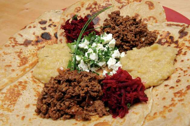 Ethiopian pancakes with ground beef, cheese and herbs, lentils and raw beet salad on Tuesday June 2, 2015 in Delmar, N.Y.  (Michael P. Farrell/Times Union) Photo: Michael P. Farrell / 00032030A