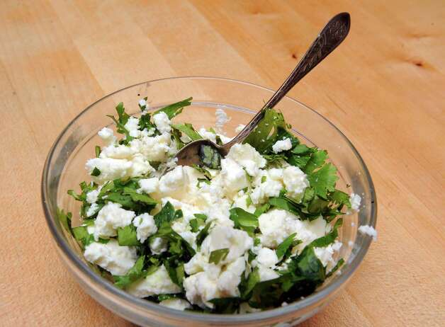Cheese and herbs on Tuesday June 2, 2015 in Delmar, N.Y.  (Michael P. Farrell/Times Union) Photo: Michael P. Farrell / 00032030A