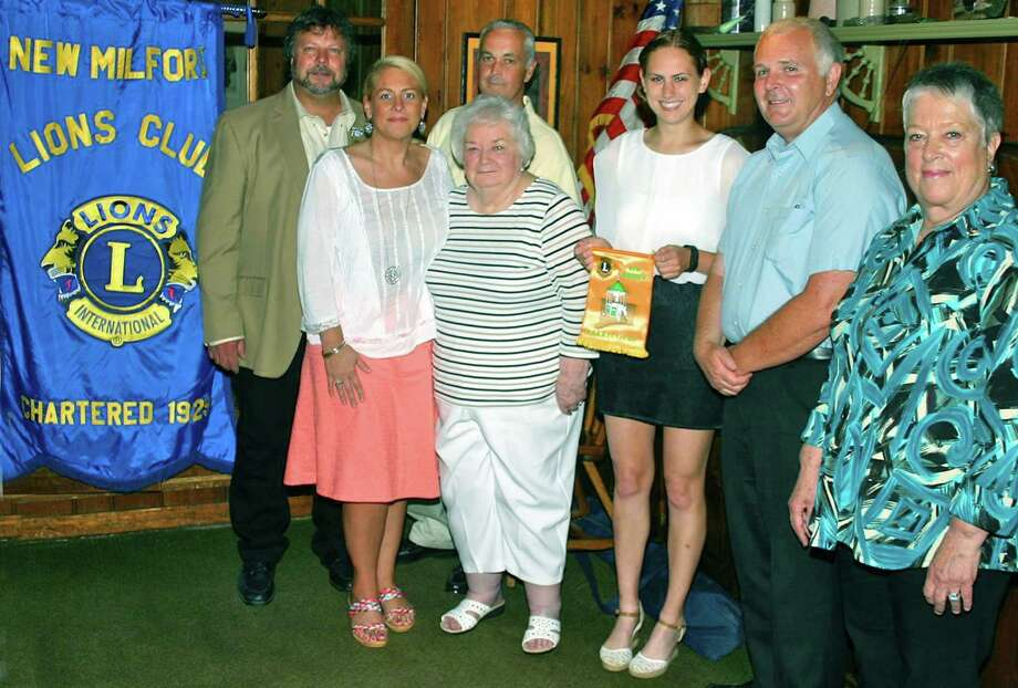 "The New Milford Lions Club recently awarded a $6,000 memorial scholarship to New Milford High School senior Charlotte Durr. The award is given in memory of longtime Lion Maurice ""Moeâ"" Grossenbacher. Among those on hand for the presentation, from left, are New Milford Lions Club President Bill Deak, Lion Renee Grossenbacher, Mary Grossenbacher, Dave Grossenbacher, scholarship recipient Durr, Bob Grossenbacher and Lion Maredith Spector. Photo: Contributed Photo / The News-Times Contributed"