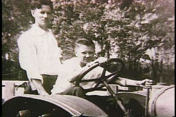 Bill Greehey, chairman of NuStar Energy, as a young boy in Fort Dodge, Iowa, sitting in a tractor with his father, William.