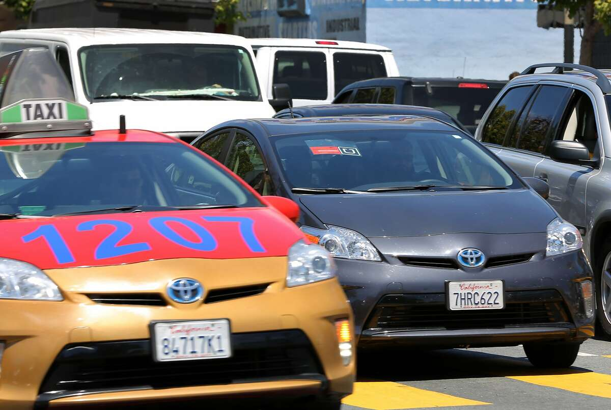 An Uber driver sits in heavy traffic on Sixth Street in San Francisco, Calif. on Wednesday, June 17, 2015. The California Labor Commission has ruled that drivers should be considered as employees of Uber and not independent contractors.