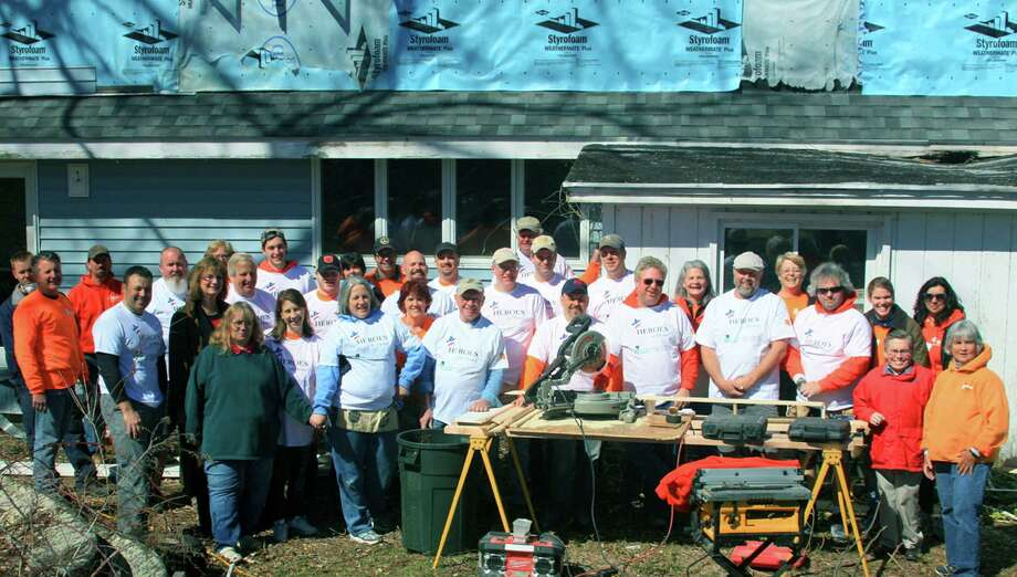 Volunteers from Rebuilding Together Litchfield Country pose for a photo during their work at the Brown-Marquardt home in New Milford. Photo: Contributed Photo / The News-Times Contributed