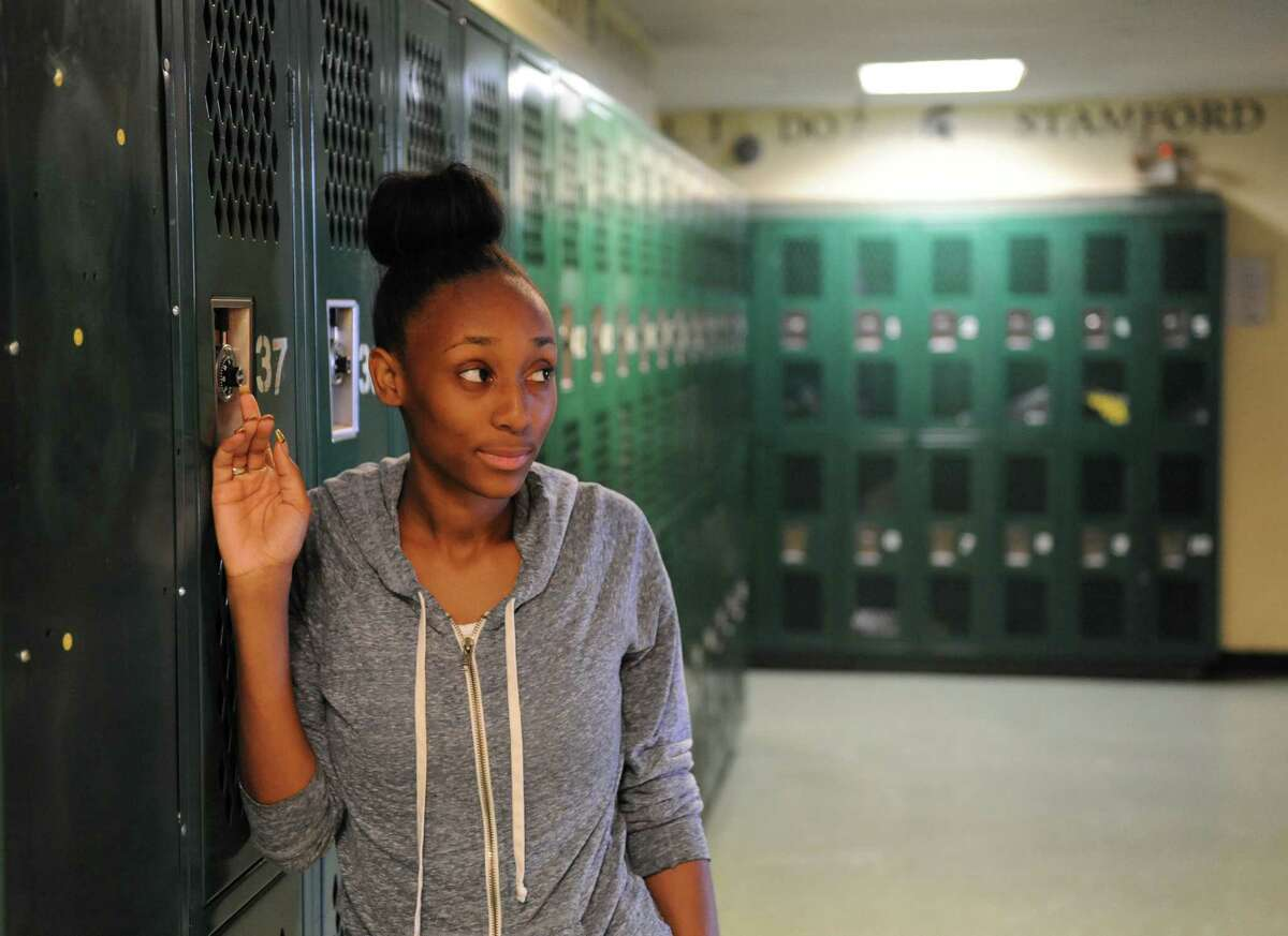 Stamford Academy graduating senior Laquariah Corder poses by the school's lockers earlier this month.