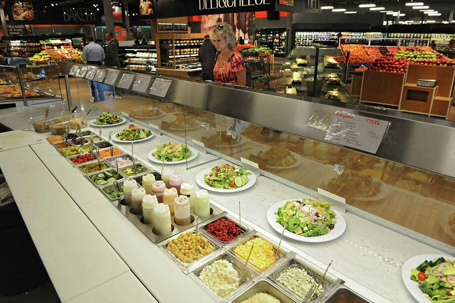 A non-traditional salad bar in the prepared foods section in the Capital Region's first Market 32, the rebranded Price Chopper on Wednesday, June 17, 2015 in Wilton, N.Y. Customers let an employee put what the customer wants on the salad. (Lori Van Buren / Times Union) Photo: Lori Van Buren / 00032290A