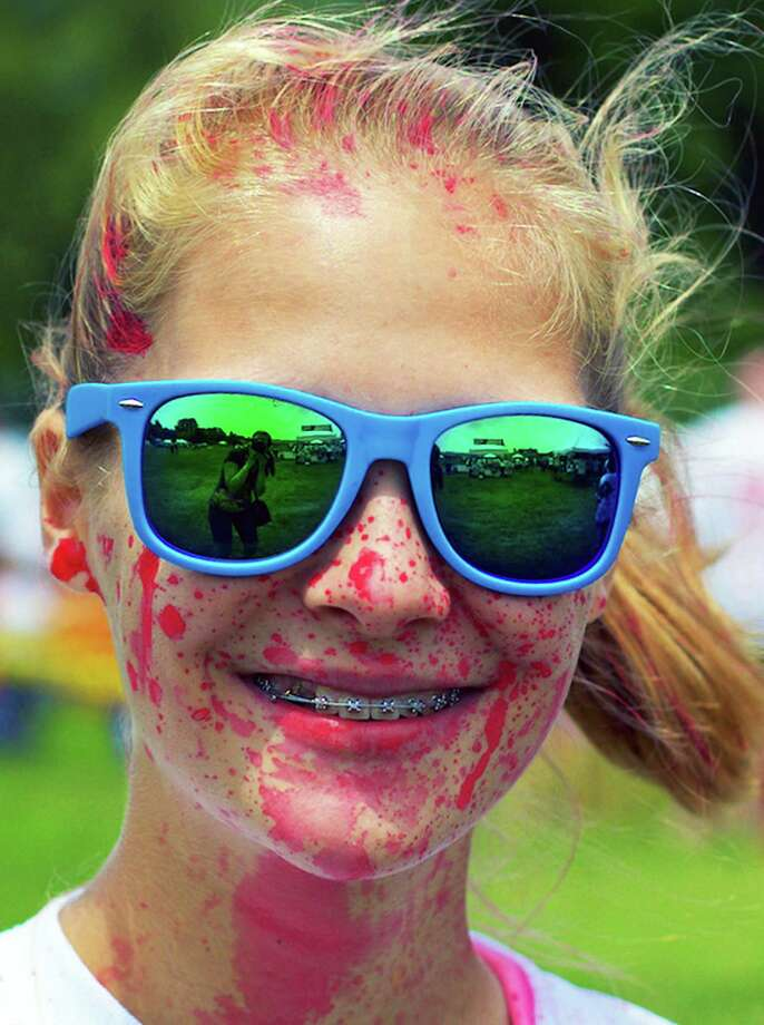 "Corinne McDougal, 15, of New Milford sports a paint-splattered yet happy visage after experiencing a fun-filled ""Splatter Battle"" during the Village Center for the Arts' annual Paint the People on June 6 on the back fields at Pettibone School. For more photos, see an upcoming edition of The Greater New Milford Spectrum and updates at www.newmilfordspectrum.com. Photo: Trish Haldin / Hearst Connecticut Media / The News-Times Freelance"