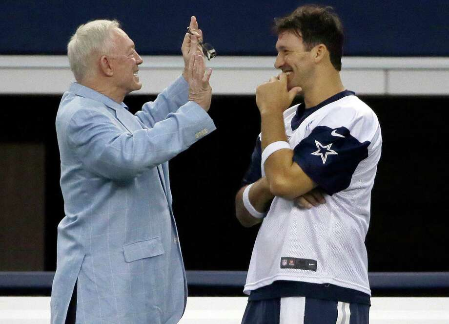 Dallas Cowboys quarterback Tony Romo, right, listens to Cowboys owner Jerry Jones as they chat on the sideline during a minicamp at the team's stadium in Arlington on June 17, 2015. Photo: LM Otero /Associated Press / AP