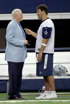 Dallas Cowboys quarterback Tony Romo and owner Jerry Jones chat on the sideline during a minicamp at the team's stadium in Arlington on June 17, 2015. Photo: LM Otero /Associated Press / AP