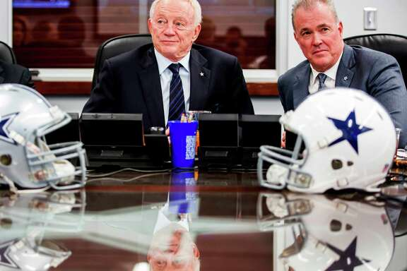 "In this April 30, 2015, file photo, Dallas Cowboys owner Jerry Jones (left) and executive vice president/COO Stephen Jones watch earlier picks in the NFL draft at the team's ""War Room"" at Valley Ranch in Irving."