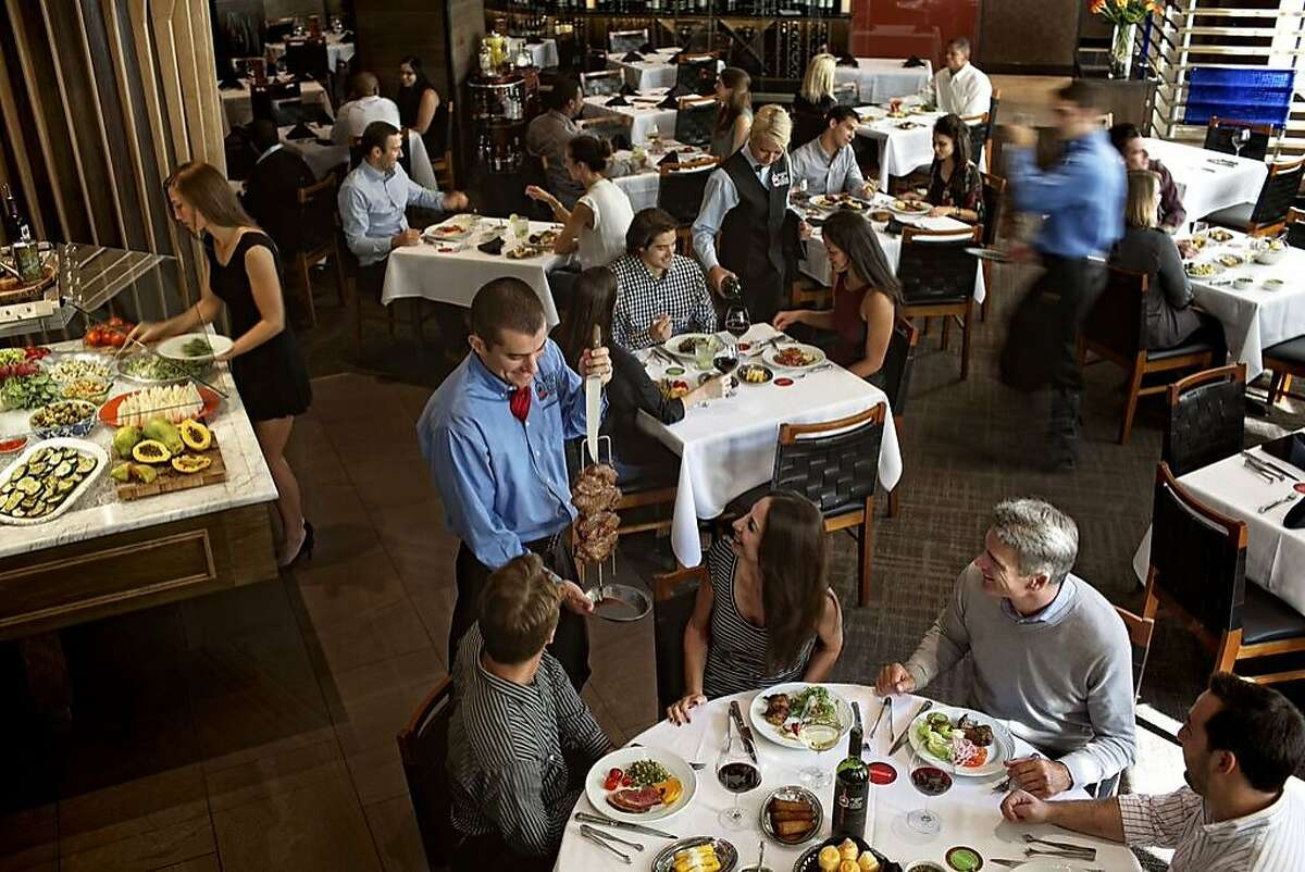 At Fogo de Chão all-you-can-eat restaurants, gaucho chefs walk the room offering customers up to 20 types of fire-grilled meats.