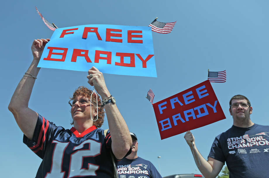 "Doreen Domina of Enfield, Conn., and her son, Jacob Domina, join Patriots fans for a ""Free Tom Brady"" rally at Gillette Stadium on May 24, 2015, in Foxborough, Mass. The fans gathered to protest the four-game suspension handed to quarterback Tom Brady over the ""Deflategate"" scandal. Photo: Angela Rowlings /Associated Press / Boston Herald"