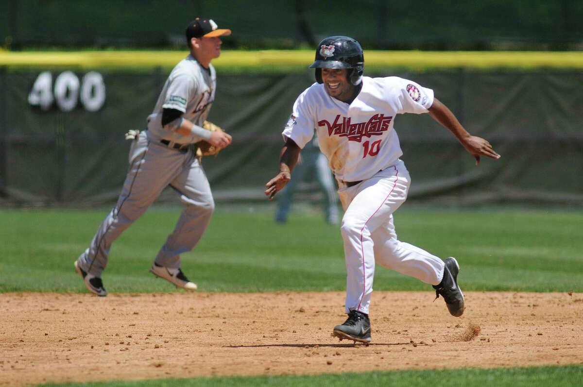 ValleyCat's Edwin Medina, right, runs to third on his way home during an exhibition game against the Dutchmen on Wednesday, June 17, 2015, at Joe Bruno Stadium in Troy, N.Y. (Cindy Schultz / Times Union)