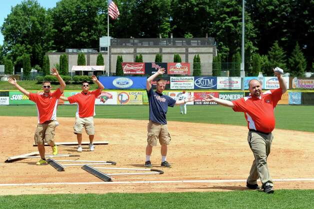 ValleyCats's grounds crew drop their infield rakes to dance and toss T-shirts during their exhibition game against the Dutchmen on Wednesday, June 17, 2015, at Joe Bruno Stadium in Troy, N.Y. (Cindy Schultz / Times Union) Photo: Cindy Schultz / 00032314A