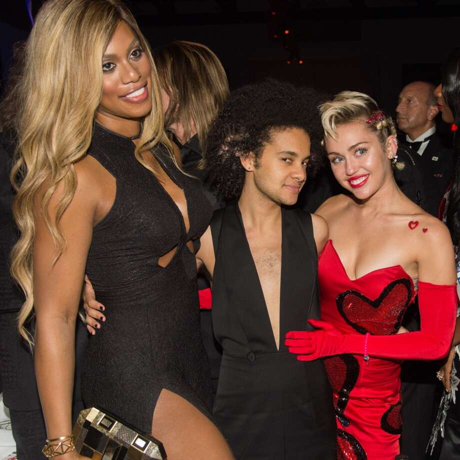 (L-R) Laverne Cox, Tyler Ford and Miley Cyrus attend the 2015 amfAR Inspiration Gala New York at Spring Studios on June 16, 2015 in New York City.  (Photo by Kevin Tachman/WireImage) Photo: Kevin Tachman, WireImage