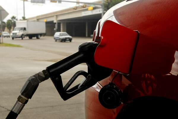 A car gets gas at an Exxon station in Brownsville, Texas Wednesday Feb. 6, 2013.Gas prices are back on the rise in Brownsville, Texas as they are nation wide. (AP Photo/The Brownsville Herald, Brad Doherty)