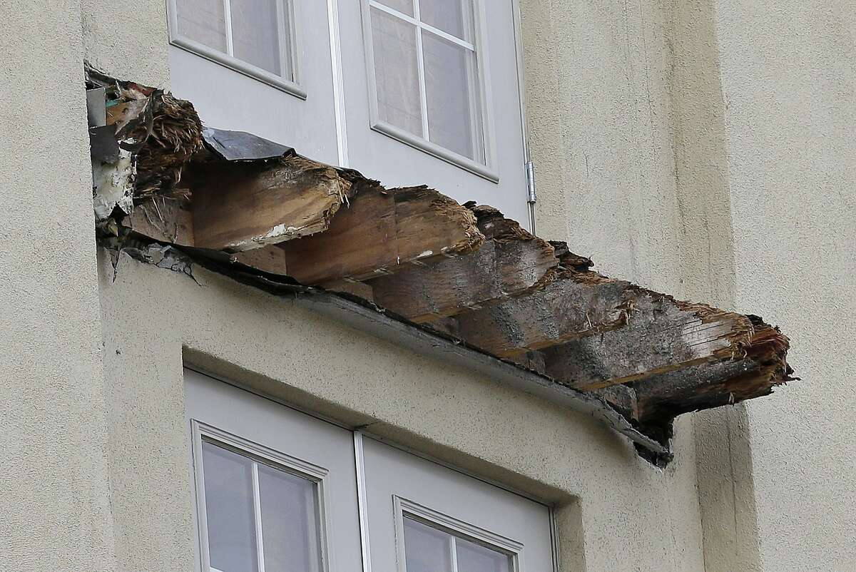 The remaining wood from the Library Gardens apartment building balcony that collapsed is shown in Berkeley, Calif., Wednesday, June 17, 2015. The balcony broke loose from the building during a 21st birthday party early Tuesday, killing several people and seriously injuring others. (AP Photo/Jeff Chiu)